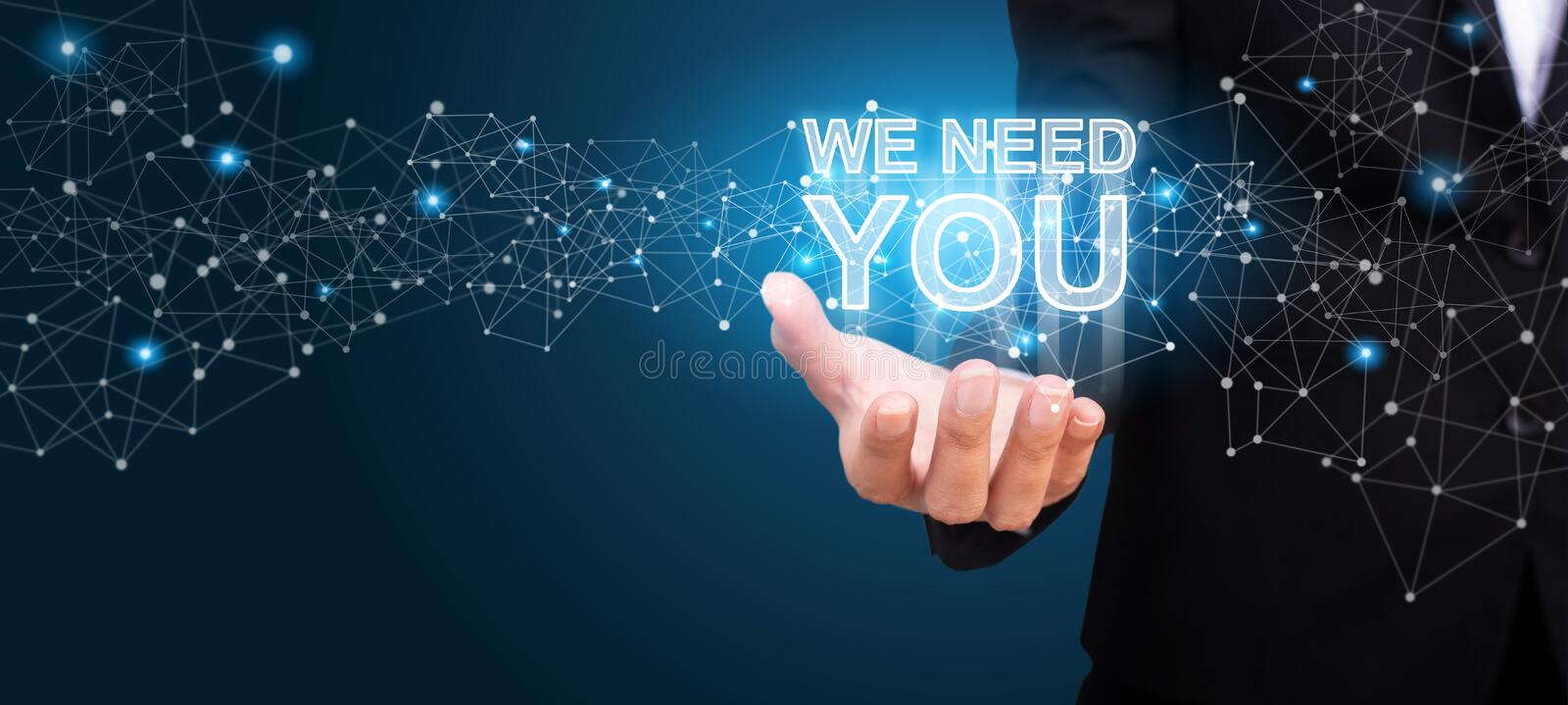 WE NEED YOU in the hand of business. We Need You concept royalty free stock image