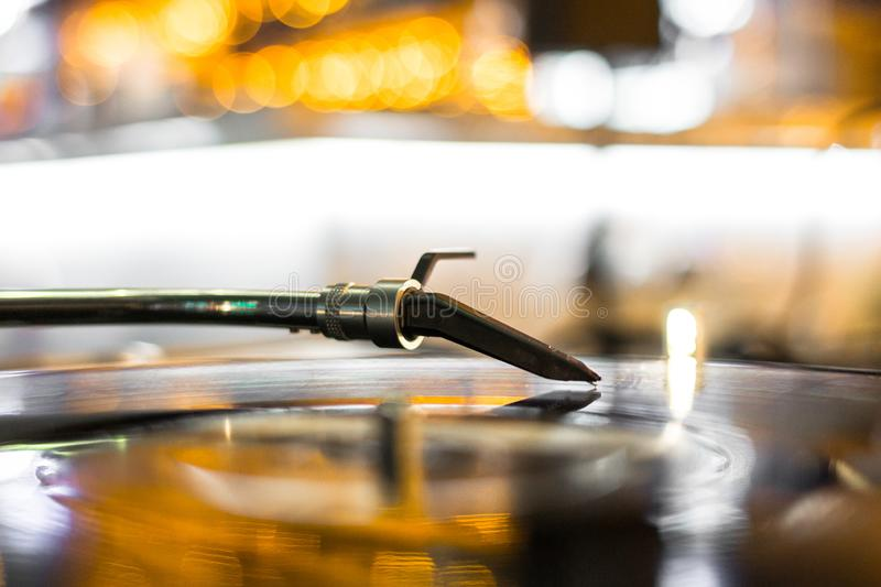 Needle on the audio track vinyl record in backlight royalty free stock image