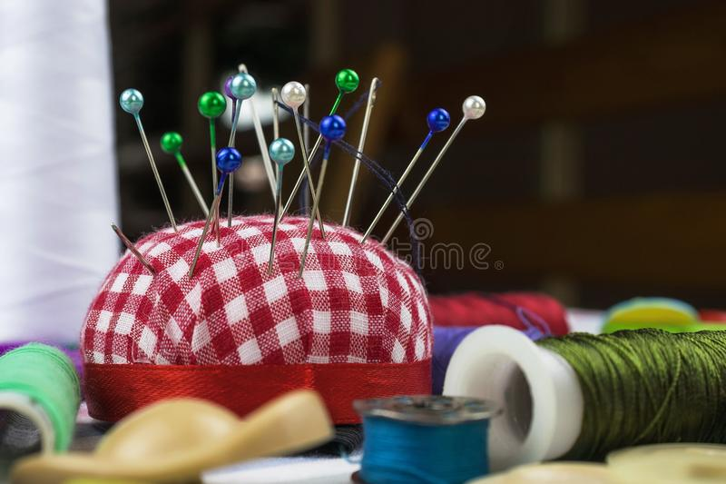 Needle in pin cushion royalty free stock photo