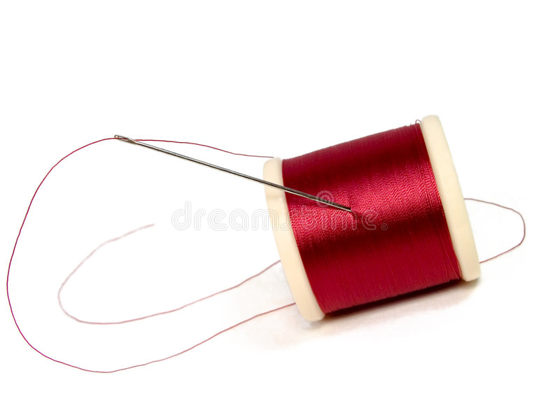 Needle and spool of thread royalty free stock photography