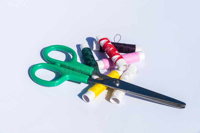 Needle, thread and scissors, sewing items stock images