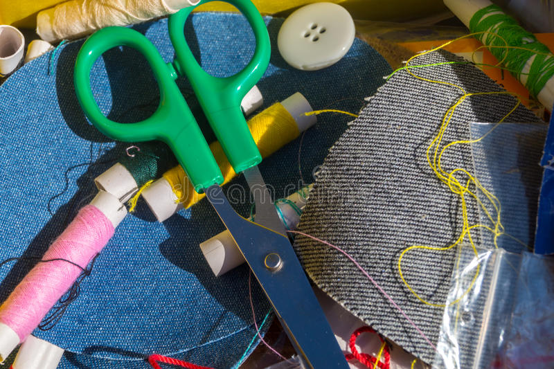 Needle, thread and scissors, sewing items royalty free stock images