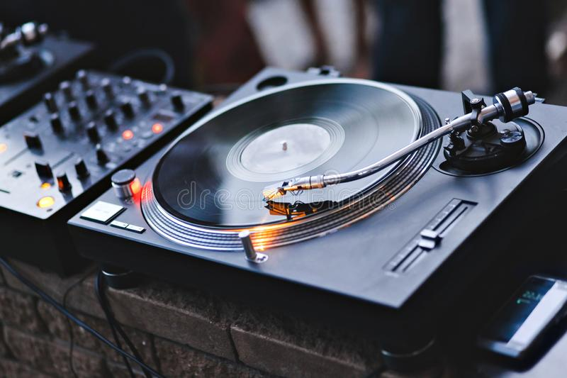 Needle on a vinyl record. Turntable vinyl record player. Sound technology for DJ to mix and play music. Vintage vinyl stock image
