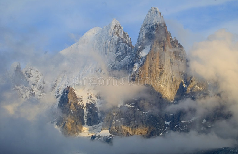 The Needles of Chamonix. France appear through clouds on a late fall afternoon royalty free stock photos