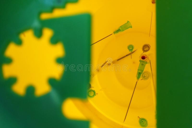 Needles in sharps container medicine royalty free stock photo
