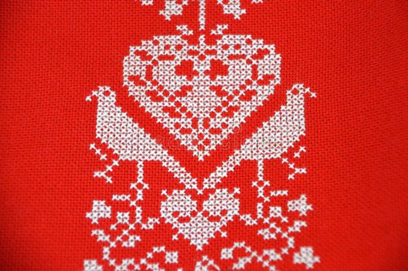 Красный цвет, Needlework, вышивка, ткань стоковая фотография rf