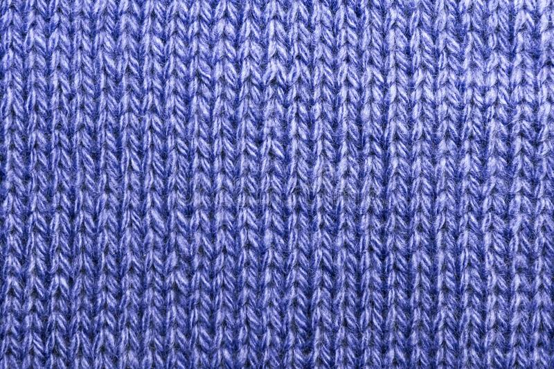 Needlework, hobbies, knitting. Background textile fabric with a knitted texture wool blue royalty free stock photos