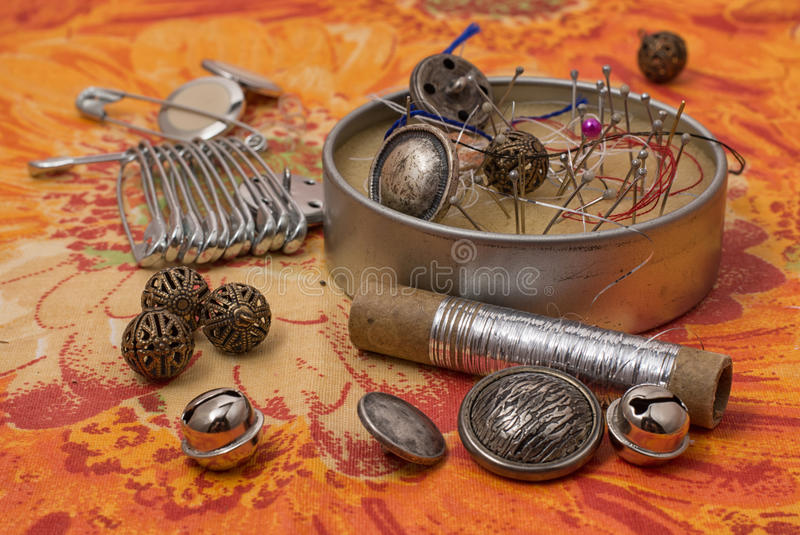 Needlework. Spool of thread,button,fabric and other items for needlework royalty free stock images
