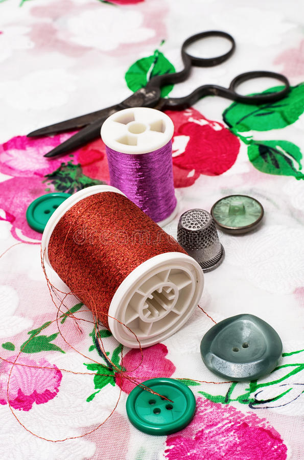 Needlework. Spool of thread,button,fabric and other items for needlework royalty free stock image