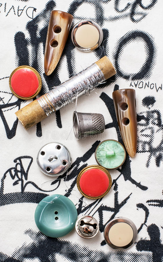 Needlework. Spool of thread,button,fabric and other items for needlework stock image