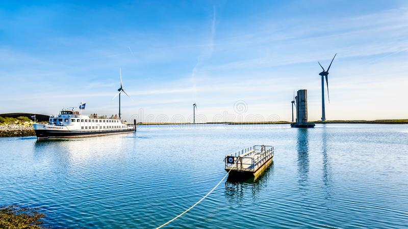 Tourist Boat at the Delta Works Storm Surge Barrier at the Oosterschelde departing from Neeltje Jans island. Neeltje Jans, Zeeland/the Netherlands - Sept 17 royalty free stock photos