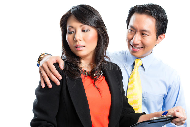 Negócio chinês asiático - acosso sexual fotografia de stock royalty free