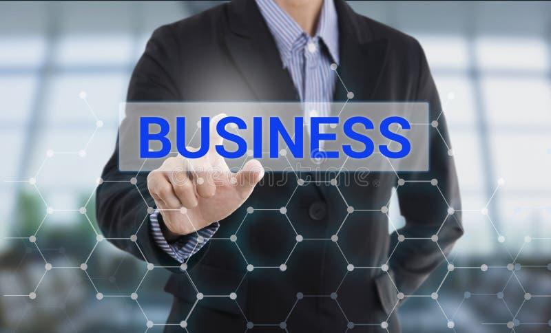 Negócio do botão da pressão de mão do homem de negócios foto de stock