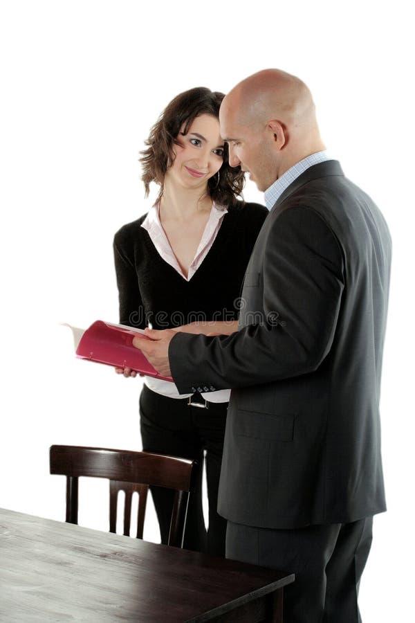Negócio - fala do homem e da mulher imagem de stock royalty free