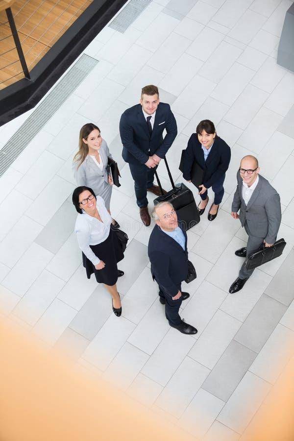 Negócio seguro Team Standing In Office Lobby imagens de stock royalty free