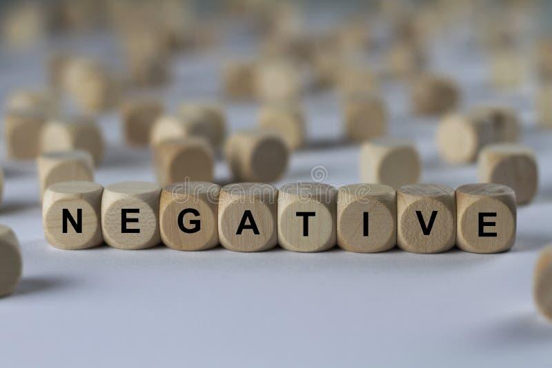 Negation - kub med bokstäver, tecken med träkuber royaltyfria foton