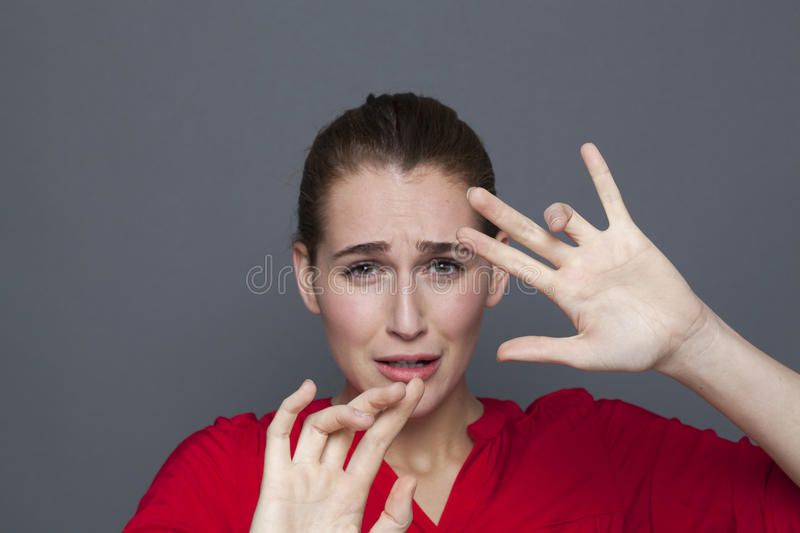 Negative feelings concept for scared 20s girl stock image
