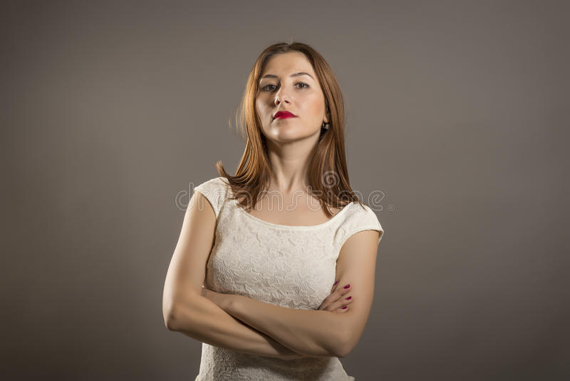 Negative human emotion. Closeup portrait displeased, off, angry, grumpy, pessimistic, arrogant, woman with bad attitude, arms crossed looking at you. Negative stock photos