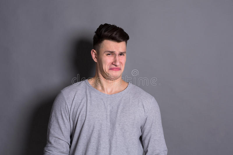 Negative human emotion, man expressing disgust royalty free stock image
