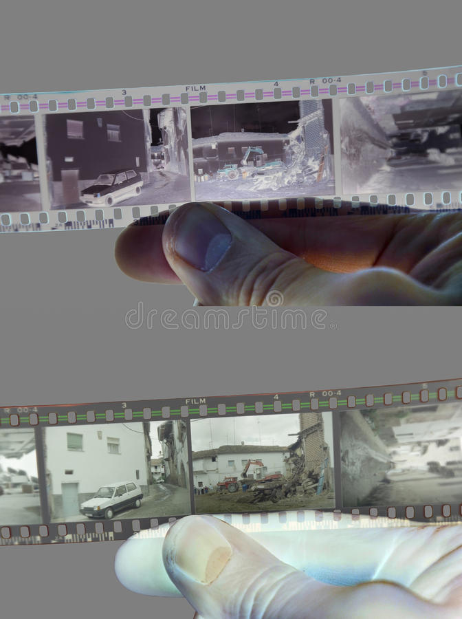 Negative-Positive. A hand taking a negative filmstrip. At the top of the image, positive version of the photography. At the bottom of the image, the negative stock photography