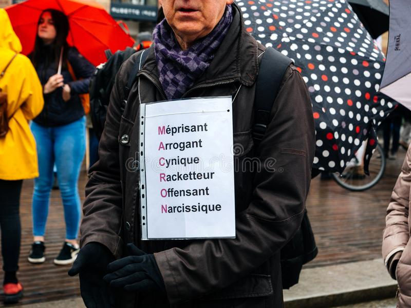 Negatives acrpnyme Macron am Protest stockbilder