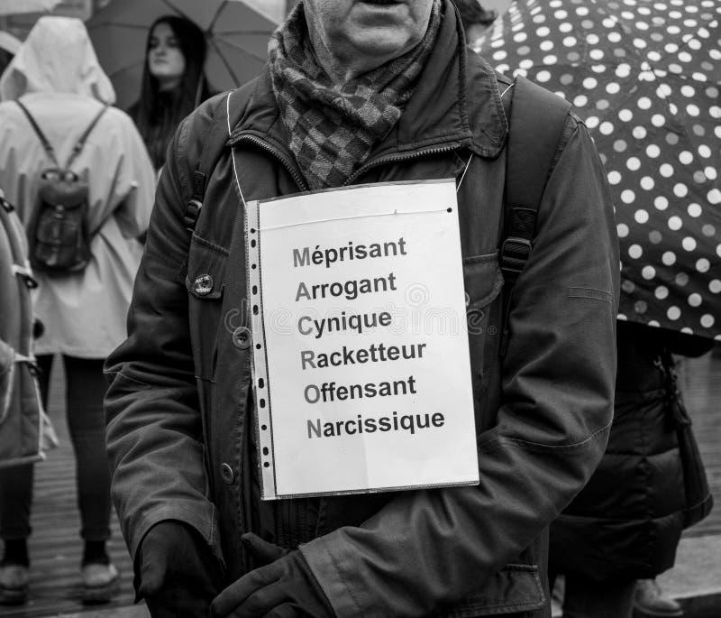 Negatives acrpnyme Macron am Protest stockbild