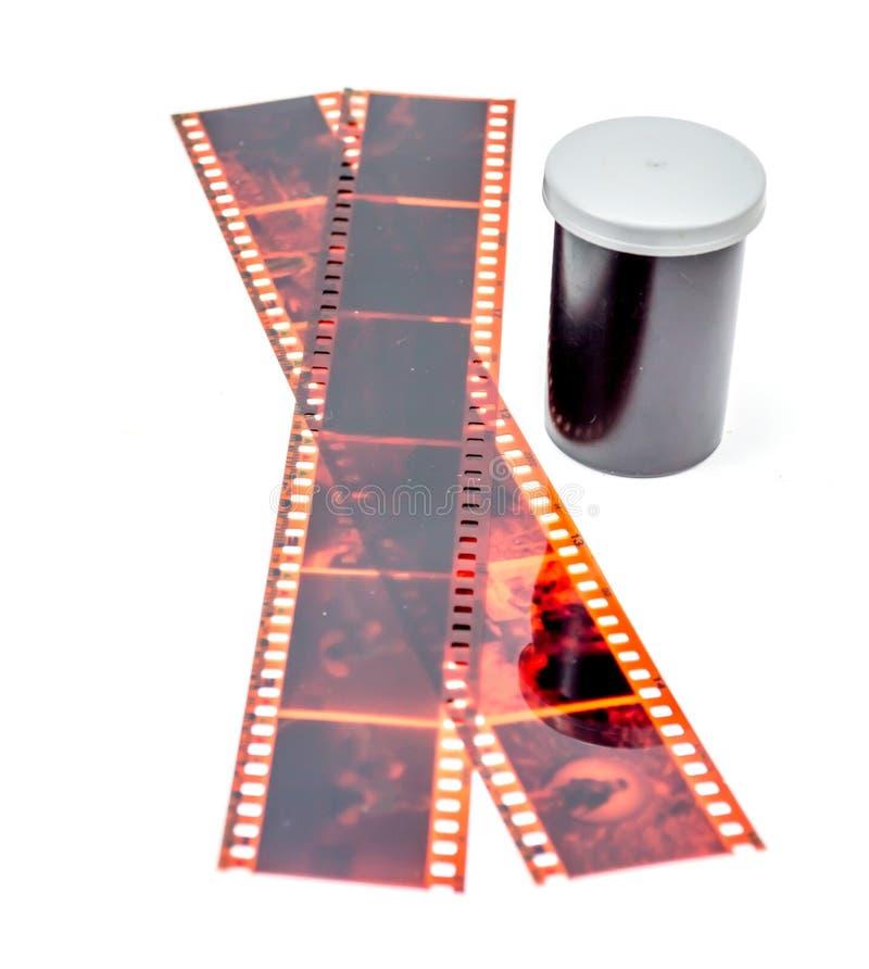 negativo de filme de 35mm e recipiente do rolo fotos de stock