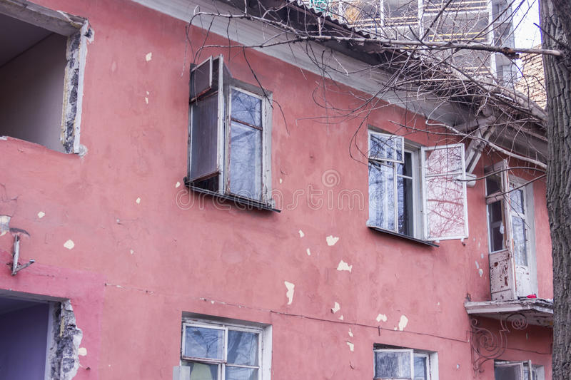 Neglected and abandoned building with garbage around. Disadvantaged areas. Homeless people royalty free stock photo