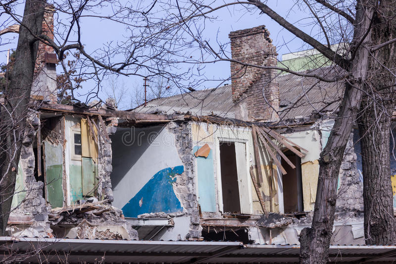Neglected and abandoned building with garbage around. Disadvantaged areas. Homeless people royalty free stock photography