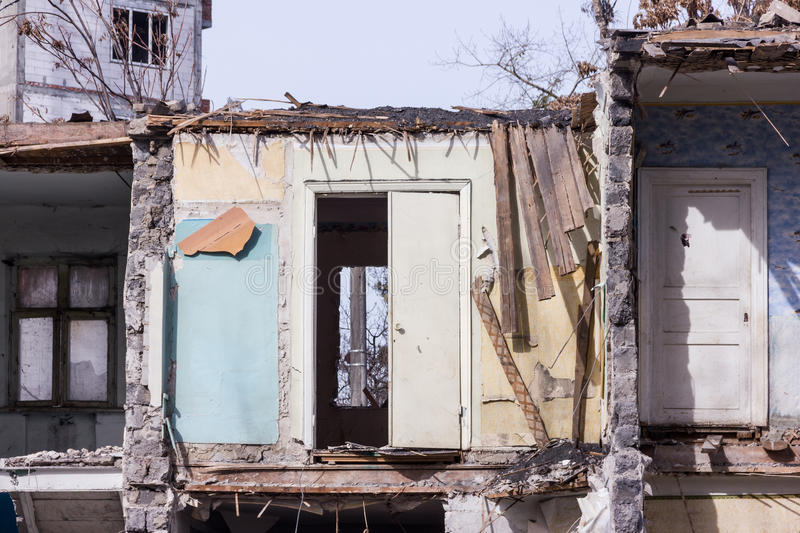Neglected and abandoned building with garbage around. Disadvantaged areas. Homeless people royalty free stock image