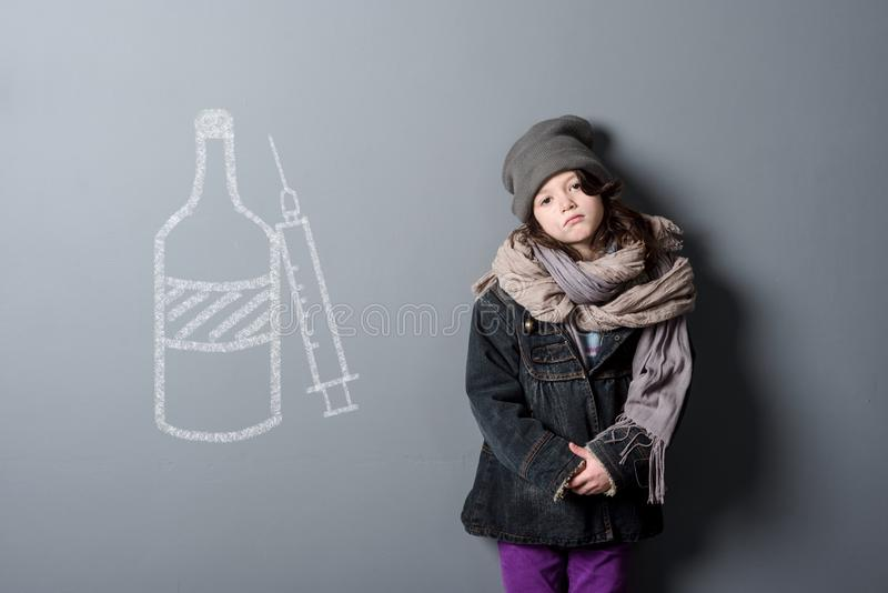 Neglected kid and drugs royalty free stock photos