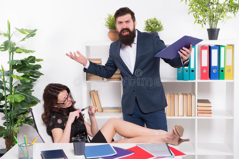 Negligence concept. Stress at work. Lazy sexy girl secretary indifferent. Manager man business report unhappy results. Negligence concept. Stress at work. Lazy royalty free stock photography