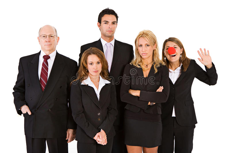 Negocio: Mujer con el payaso Nose Having Fun con el equipo serio imagen de archivo
