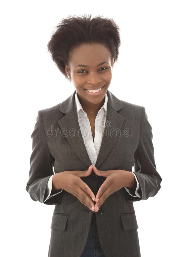 Negocio: mujer negra satisfecha que mira la cámara aislada en wh imagenes de archivo