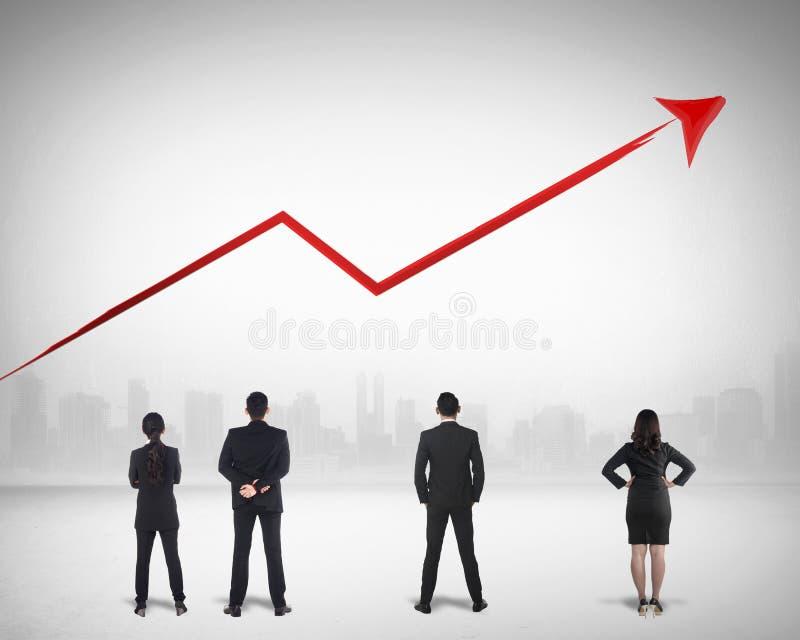Negocio Team Watching Sales Grow Up imagen de archivo