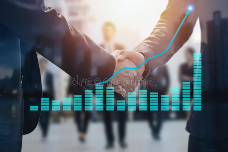 Negotiating business concept, two businessman shaking hand after. Successful connection and deal about investment and team corporate, finance graph and up arrow stock photos