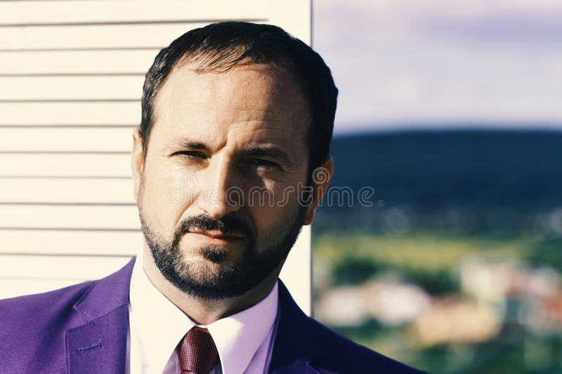Negotiation and business concept. Businessman wears smart suit and tie on wooden wall royalty free stock images