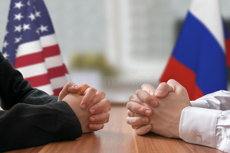 Negotiation of USA and Russia. Statesman or politicians with clasped hands.  royalty free stock photo