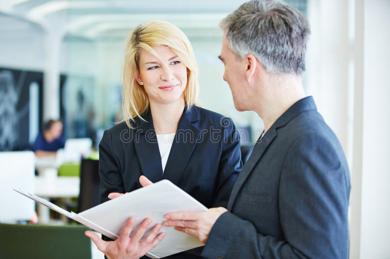 Negotiations in office lead. To success for business men and woman royalty free stock photo