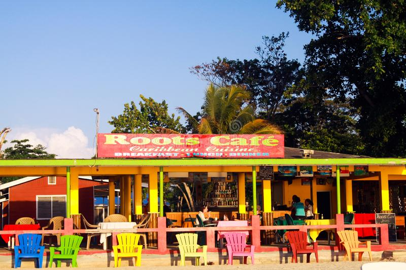 NEGRIL, JAMAICA - MAY 24. 2010: Colorful cafe and restaurant on Bourbon beach royalty free stock photography