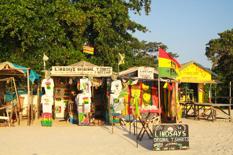 NEGRIL, JAMAICA - MAY 24. 2010: Gift and handicraft shops on Bourbon beach stock image