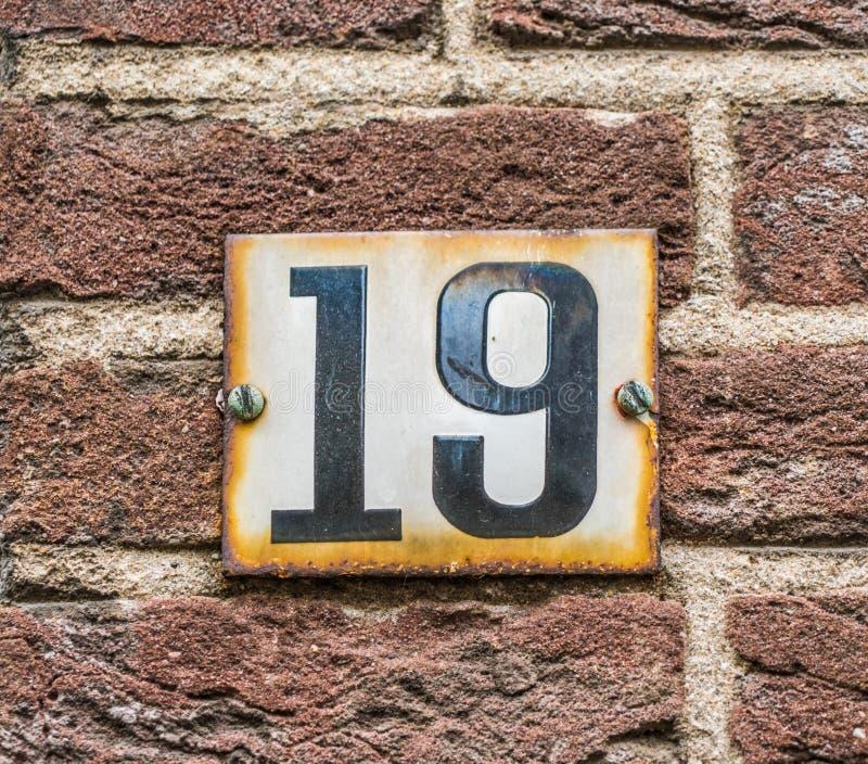 Negro del número de casa 19 en blanco foto de archivo libre de regalías