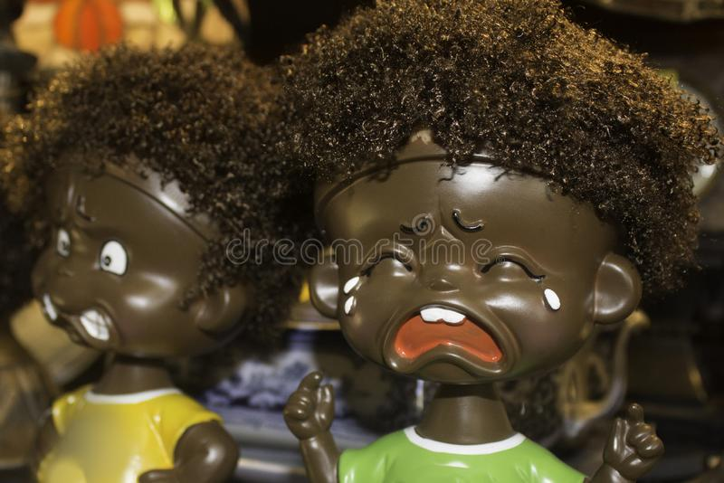 Crying negro doll with second doll in background stock photo