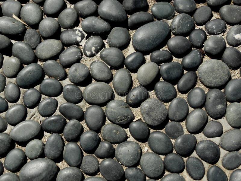 Negro y Gray Flat Stones imagenes de archivo
