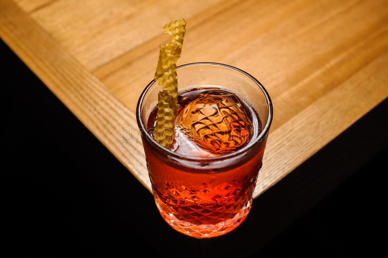 Negroni in crystal glass with dried honeycombs stock photos