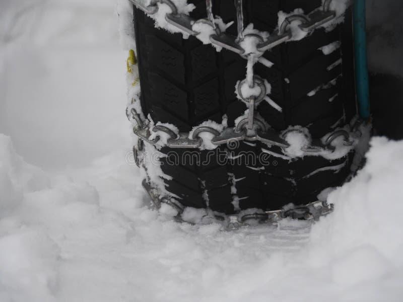 Neige à chaînes de tryre photos stock