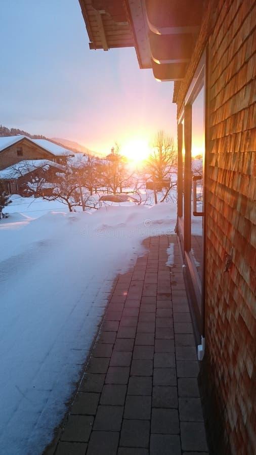 Neige de coucher du soleil photographie stock