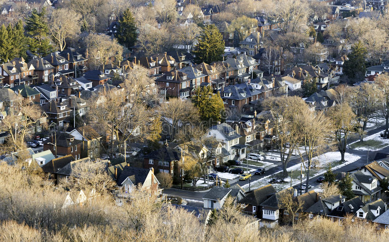 Neighborhood community seen from above at sunrise, houses stock photography