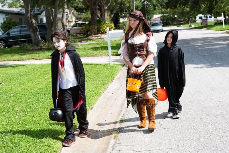 Neighborhood Kids Trick or Treat royalty free stock photos