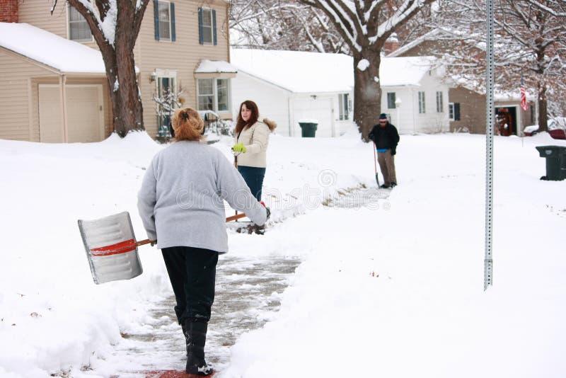 Neighbors Shoveling Heavy Snowfall royalty free stock photography